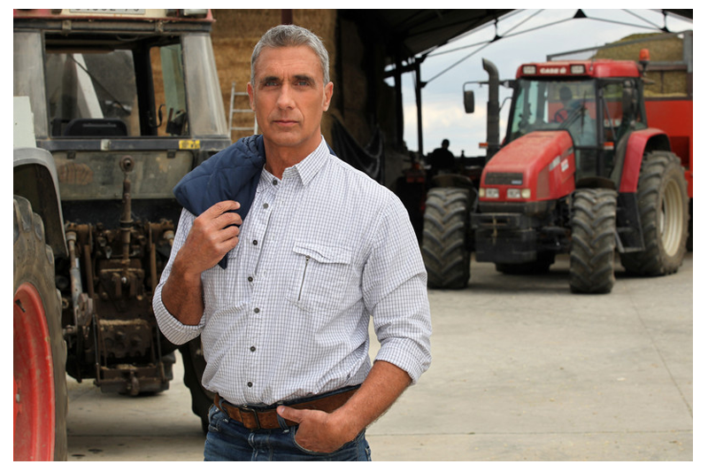 farmer with tractor and two way radio